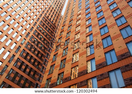 office buildings with brick and glass and reflections of sky - stock photo