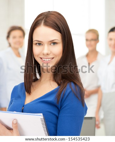 office, buisness, education concept - happy woman with big notepad