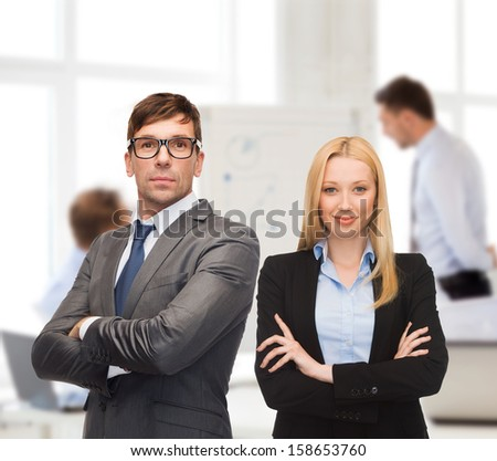 office, buisness, teamwork concept - businessman and businesswoman in the front of team - stock photo