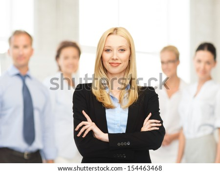 office, buisness, teamwork concept - friendly young smiling businesswoman - stock photo