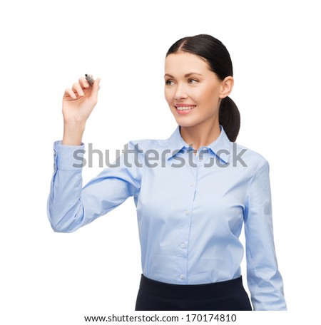 office, business and new technology concept - businesswoman writing something in the air with marker - stock photo