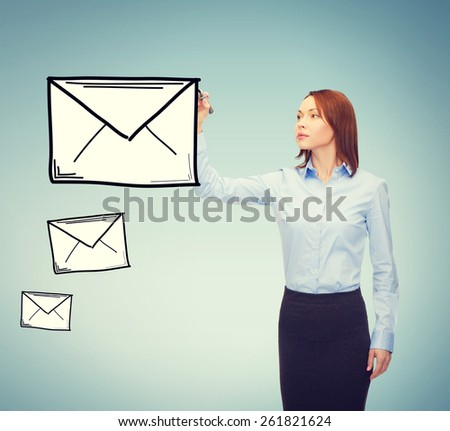 office, business and new technology concept - smiling businesswoman drawing envelope on virtual screen - stock photo