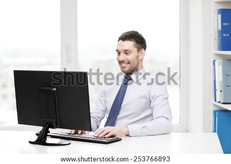 office, business, education, technology and internet concept - smiling businessman or student with computer
