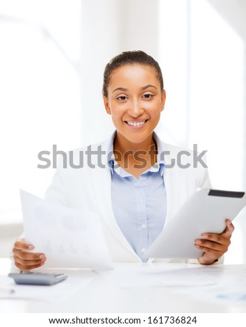 office, business, technology and internet concept - businesswoman with tablet pc in office - stock photo