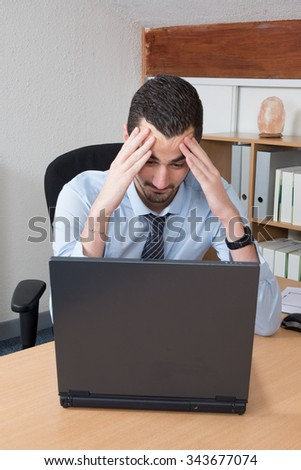 Office, business, technology, finances and internet concept - businessman with laptop computer and documents at office
