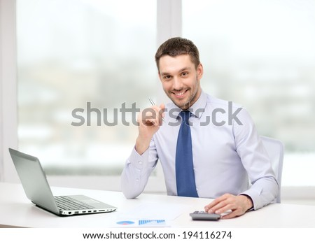 office, business, technology, finances and internet concept - smiling businessman with laptop computer and documents at office - stock photo