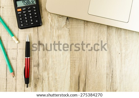 Office, business tools on wooden table - stock photo