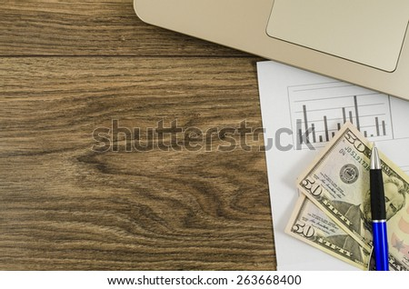 Office, business tools with dollar on wooden table - stock photo