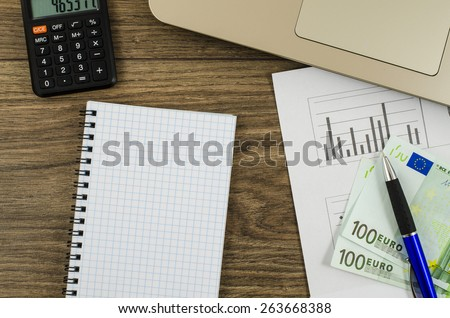 Office, business tools with notebook and euro on wooden table - stock photo