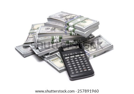 Office calculator and stack of new one hundred United States Dollar bills ($100 USD) over white background. Success, Business, Accounting concept. - stock photo