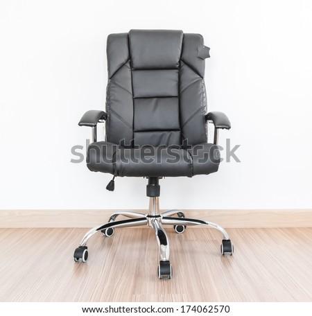 Office chair on laminate flooring - stock photo