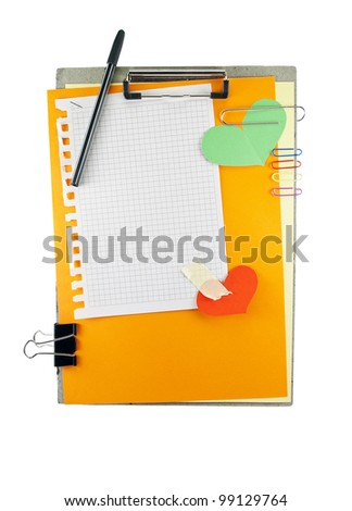 Office clipboard with colorful paper sheets, clips, pen and square pattern sheet.