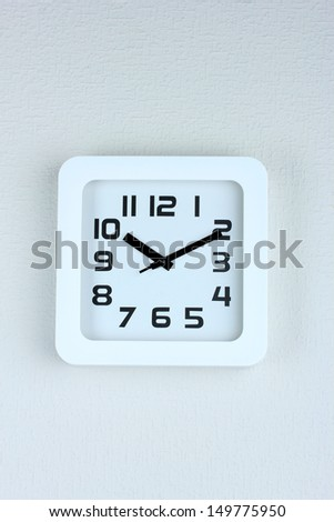 Office clock on color wall background
