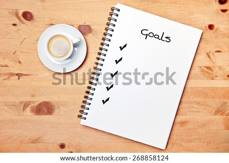 office - coffee - writing pad - goal checklist