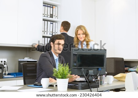 Office colleagues working together in a project - stock photo
