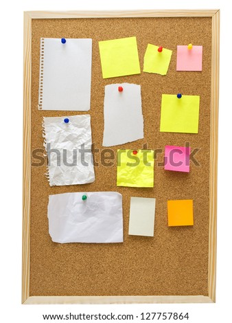 office cork board with yellow post it notes, isolated on white - stock photo