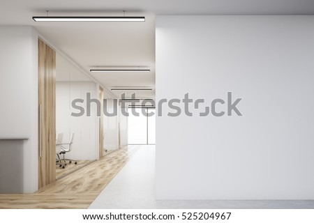 Office Corridor With Large Blank Wall And Row Of Conference Rooms With  Wooden Wall And Floor