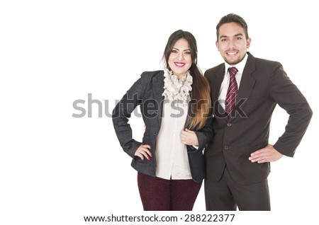 Office couple in formal clothes smiling to camera