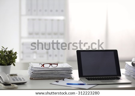 office desk a stack of computer paper reports work forms - stock photo