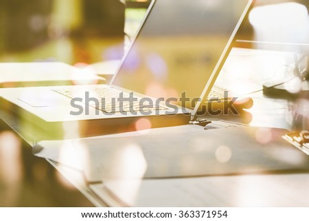 Office desk and defocused city night light background