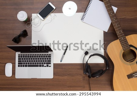 Office desk background, Acoustic guitar and headphones recording scene project ideas concept, With laptop computer, mobile phones, drawing equipment and cup of coffee. View from above with copy space - stock photo