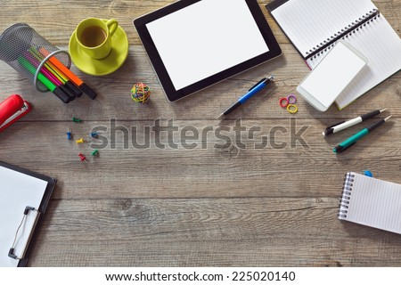 Office desk background with tablet, smart phone and cup of coffee. View from above with copy space - stock photo
