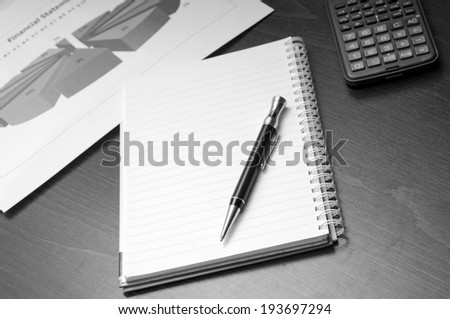 Office desk concept with pad, pen, calculator in view - stock photo