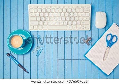 Office desk flat lay with keyboard, coffee cup and notebook. View from above. Retro filter effect - stock photo