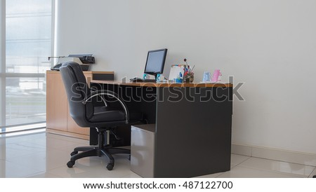 Office desk in bright light with computer, Office equipment, dry rose.
