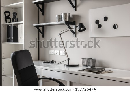 office desk in modern style in black and white tones - stock photo