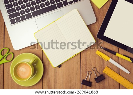 Office desk mock up template with laptop, notebook and tablet. View from above - stock photo