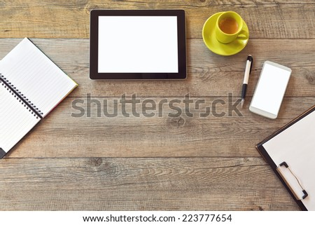 Office desk mock up template with tablet, smart phone, notebook and cup of coffee. View from above with copy space - stock photo