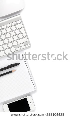 Office desk table with computer and supplies. Isolated on white background. Top view with copy space - stock photo