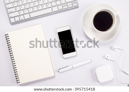 Office desk table with computer, supplies, analysis chart, calculator, pen, cup of coffee and flower. Top view with copy space (selective focus) - stock photo