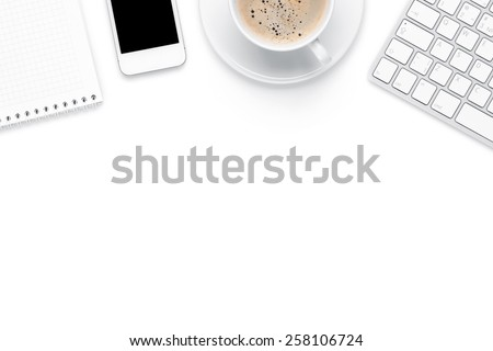 Office desk table with computer, supplies and coffee cup. Isolated on white background. Top view with copy space - stock photo