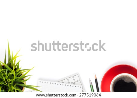 Office desk table with computer, supplies, coffee cup and flower. Isolated on white background. Top view with copy space - stock photo