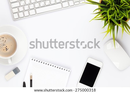 Office desk table with computer, supplies, flower and coffee cup. Top view with copy space  - stock photo