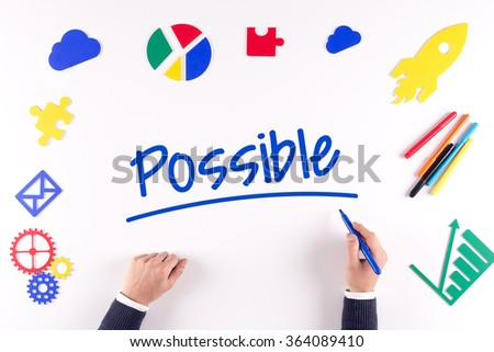 Office desk with a single word Possible - stock photo