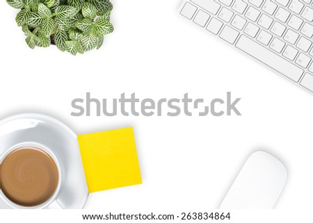 Office desk with coffee cup , computer keyboard and computer mouse on table. View from above with copy space on white background. - stock photo