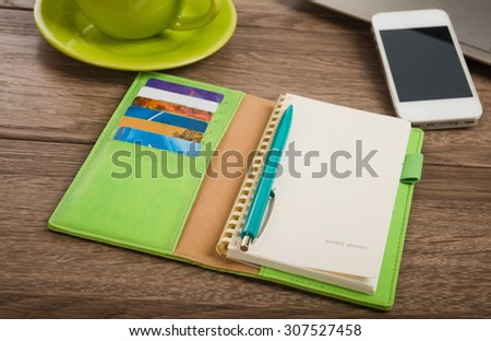 Office desk with laptop computer, tablet pc, planner, pen, mobile smartphone and cup of tea.  - stock photo