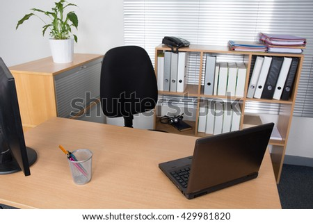 Office desk with laptop, job or business concept