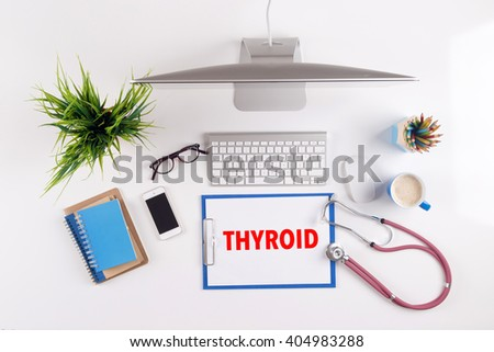 Office desk with THYROID paperwork and other objects around, top view - stock photo