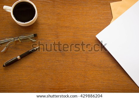 Office desk, work place with cup of coffee,Empty workspace on white table.