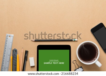 Office desk,Working on a Wooden Table with tablet - stock photo