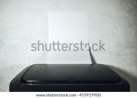 Office desktop laser printer with blank paper of A4 or letter size as copy space coming out from output tray, selective focus - stock photo