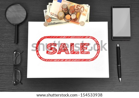 Office desktop, paper with sale and money - stock photo
