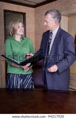 Office discussion between manager and admin - stock photo