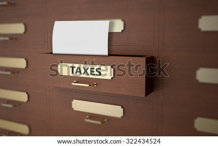 Office drawers with text on the subject of taxes - stock photo