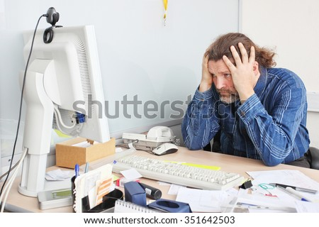 Office employee works on his working place