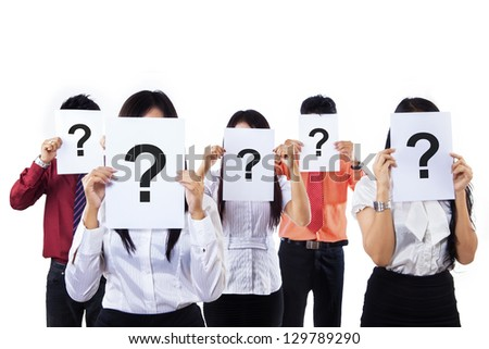 Office employees standing while holding a paper with a question mark - stock photo